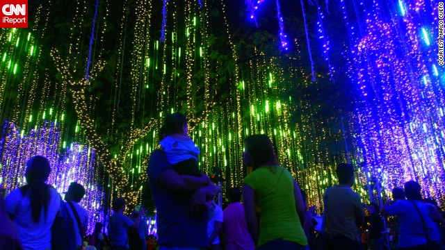 "<a href='http://ireport.cnn.com/docs/DOC-1066982' target='_blank'>Marlo Cueto </a>photographed an annual lights and sound show in the Philippines. ""With thousands of lights dangling from the trees of Ayala Triangle Gardens, people enjoyed watching the show as the lights of variety of colors dance to the tune of Christmas medley,"" he says.This year's show is dedicated to the victims of the recent typhoon."