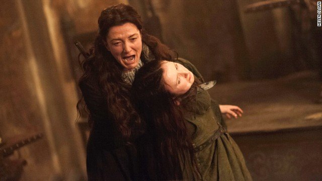 Catelyn Stark (Michelle Fairley) seizes Walder Frey's wife (Kelly Long) in an episode of
