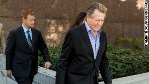 Actor Ryan O\'Neal, center, and son, Redmond O\'Neal, exit court for a lunch break on Thursday, December 12, 2013, in Los Angles.