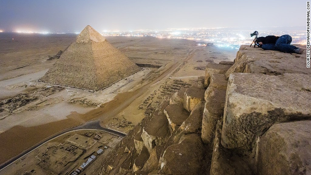 A group of Russian photographers ignored regulations, climbed the Pyramids at Giza, Egypt, and came away with spectacular photos. The pics incited indignation over the protection of the ancient wonders.