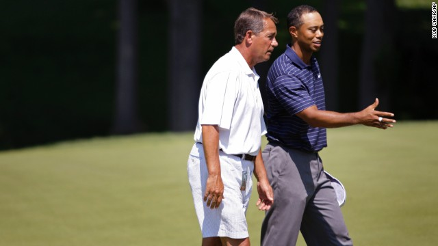 Boehner, an avid golfer, talks with Tiger Woods while golfing at the Congressional Country Club in Bethesda, Maryland, in 2009.