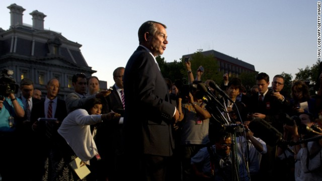 Boehner speaks to the media after a meeting with President Obama at the White House on October 2, the second day of the federal government's recent shutdown. The White House squared off with Republican rivals in Congress over how to fund federal agencies, many of which were forced to close, leaving a fragile economy at risk.