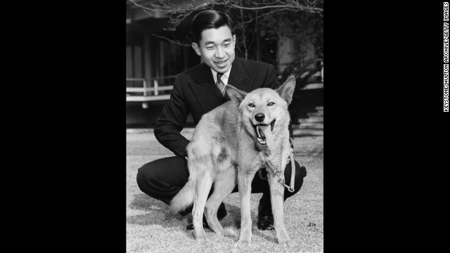 Akihito with his pet dog Dingo in December 1963, on the grounds of Togu Palace, his residence in Tokyo.