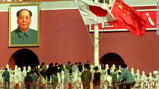 Visitors to China's Forbidden City walk beneath Japanese and Chinese flags, flown to welcome Emperor Akihito on October 23,1992. Akihito's visit to China was the first ever by a Japanese emperor.