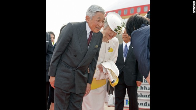 Emperor Akihito and Empress Michiko are greeted at Chennai International Airport in India on December 4, 2013, after arriving from New Delhi on the second leg of their weeklong trip to India. This was the first time they had been to India in 53 years.