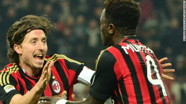 Sulley Muntari celebrates his late equalizer for AC Milan in the San Siro against AS Roma.