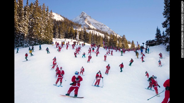 Santas ski from Uley's Ice Bar on Crested Butte Mountain in Crested Butte, Colorado, for the first 'Santa Ski Crawl' on Saturday, December 14.