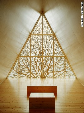 Made almost entirely of wood, the chapel features an intricate carving of a tree, a modern take on the traditional leadlight window. Designed by Vesa Oiva.