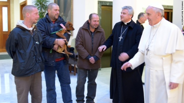 Pope Francis marked his 77th birthday on December 17 by hosting homeless men to a Mass and a meal at the Vatican. One of the men brought his dog.