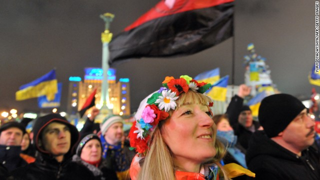 A girl wearing a traditional Ukrainian wreath attends an opposition rally in Independence Square on December 17.