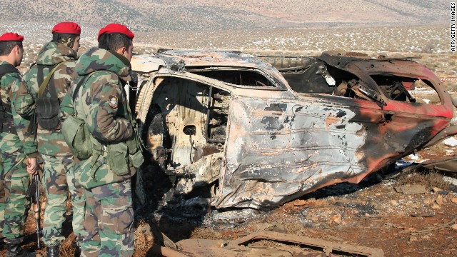 Lebanese soldiers stand next to the wreckage of a van following an explosion in the Bekaa valley on December 17.