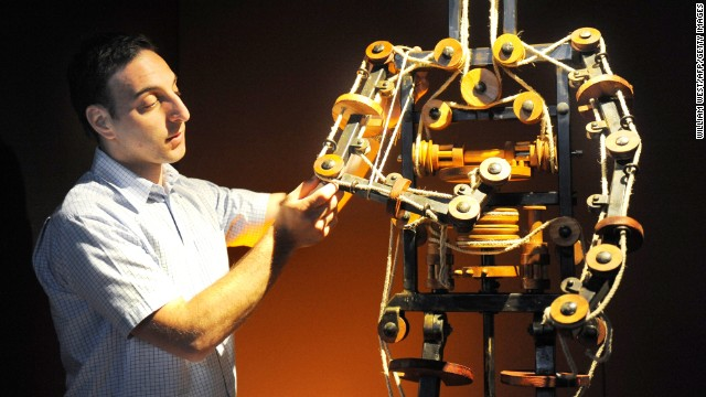 "Massimo Ingrosso inspects the complete mechanism of a robot at a 2009 Leonardo da Vinci exhibition at which the famed inventor's creations, including a 1495 ""automaton,"" were brought to life."
