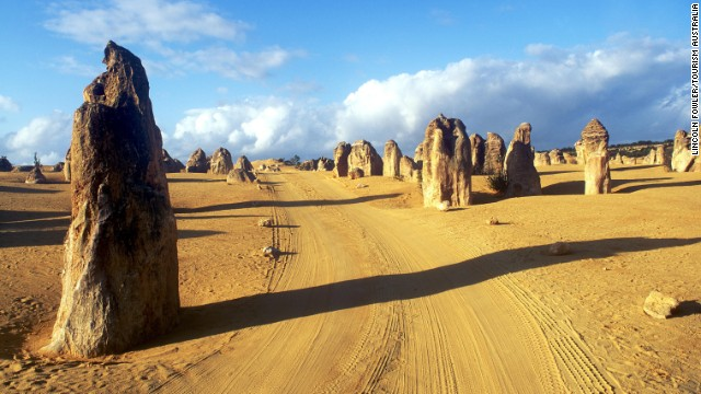 Freezing at home? Head to the Southern Hemisphere for a nice, warm getaway. Limestone formations known as the Pinnacles are located within Nambung National Park along the coast of the Indian Ocean in Western Australia.
