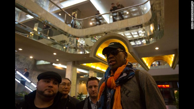 "Former NBA basketball player Dennis Rodman attracts notice as he enters the Koryo Hotel in Pyongyang, North Korea, on Thursday, December 19. In his latest round of ""basketball diplomacy,"" Rodman is making his third visit to North Korea, one of the world's most repressive regimes."