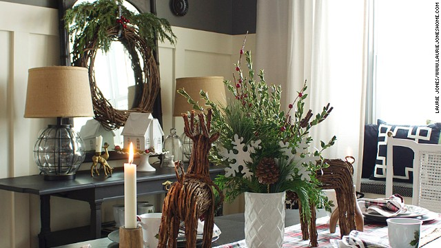 Jones' dining room includes deer figurines made of vine and a vine wreath with sprays of cut greens.