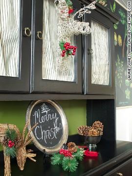 A trophy deer head made of vine lends a whimsical take on woodland Christmas decor.