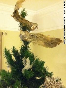 Fanciful peacocks top Norwood's Christmas tree.