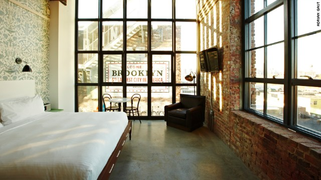 Once a cooperage, Brooklyn's Wythe Hotel offers floor-to-ceiling windows in many rooms that look straight out onto the Manhattan skyline over the East River,