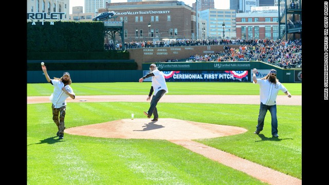 Jase, Si and Willie throw out the ceremonial first pitch before a Major League Baseball game in Detroit in September.
