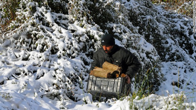 A Syrian refugee carries firewood in the Lebanese village of Hammana.