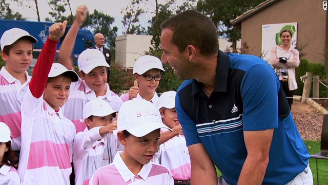 Garcia enjoying a joke with the kids of his junior golf academy at the PGA Catalunya Resort, Barcelona. The 33-year-old dropped by in October this year to celebrate its one-year anniversary.