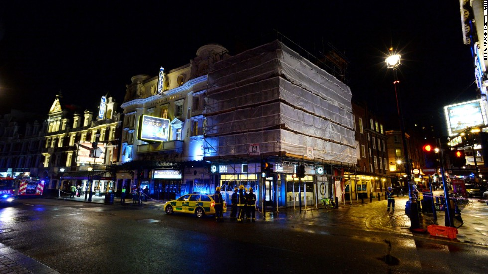 Emergency service personnel work outside London's Apollo Theatre on Thursday, December 19. Part of the theater's ceiling collapsed during a performance Thursday night, injuring dozens of people, officials said.