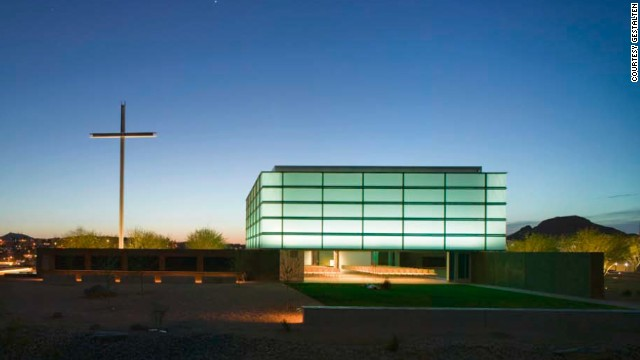Effortlessly opening to the surrounding desert, the innovative 250-seat glass and steel prayer chapel sits atop four site-cast, pin-wheeling concrete walls. The double-skinned Pavilion of Light is composed of shading and insulating systems.