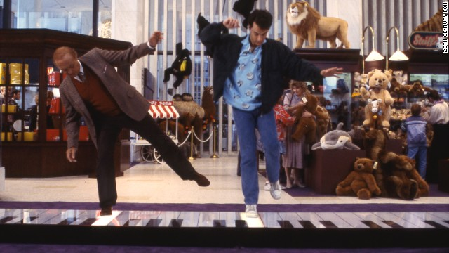Actors Robert Loggia, left, and Tom Hanks in the famous piano scene from the movie