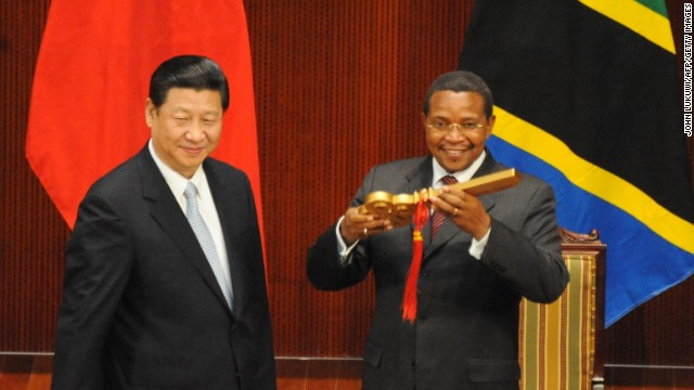 Chinese president Xi Jinping hands over the symbolic golden key to Tanzania President Jakaya Kikwete. The China National Petroleum Company is currently installing a 330-mile natural gas pipeline in Tanzania.