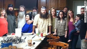 S.E. Cupp, with the Robertson family, featured in \