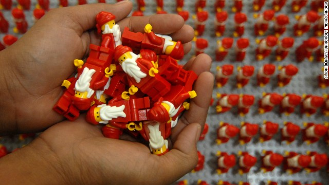 Women organize thousands of Lego Santa Clauses on Wednesday, December 18, in Surabaya, Indonesia.