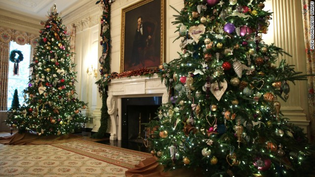 Holiday decorations are displayed in the State Dining Room.