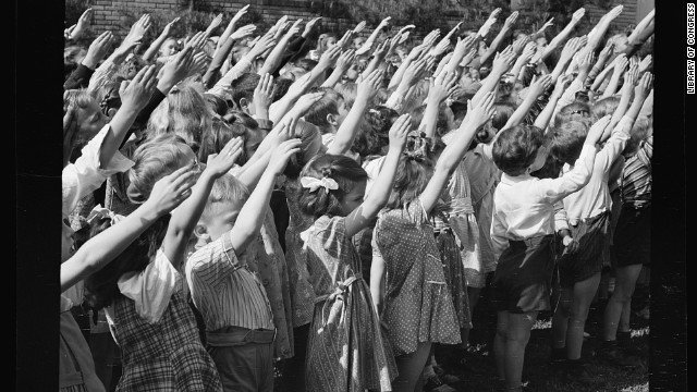 Southington, Connecticut school children pledge their allegiance to the flag, in May 1942.