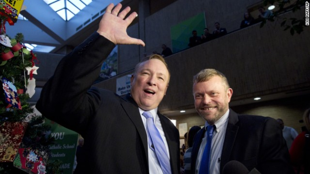 Utah state Sen. Jim Dabakis, left, and Stephen Justesen acknowledge the crowd after being married in Salt Lake City on Friday, December 20. A federal judge struck down Utah's ban on same-sex marriage, saying it conflicted with the constitutional guarantees of equal protection and due process. Many Utah counties began issuing marriage licenses before the state appealed to the U.S. Supreme Court. The high court temporarily blocked enforcement of the lower court ruling until the constitutional questions were fully resolved.