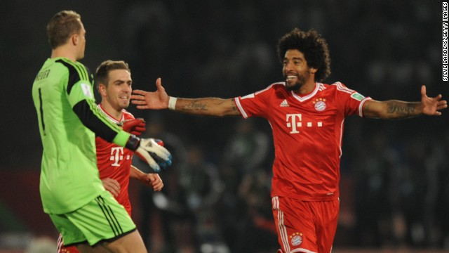 Bayern Munich's Dante, right, celebrates with his teammates after scoring in the Club World Cup final.
