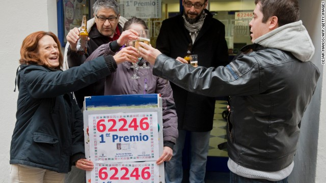 Lottery Administration owners and locals celebrate having sold a first prize ticket in Spain's Christmas lottery named