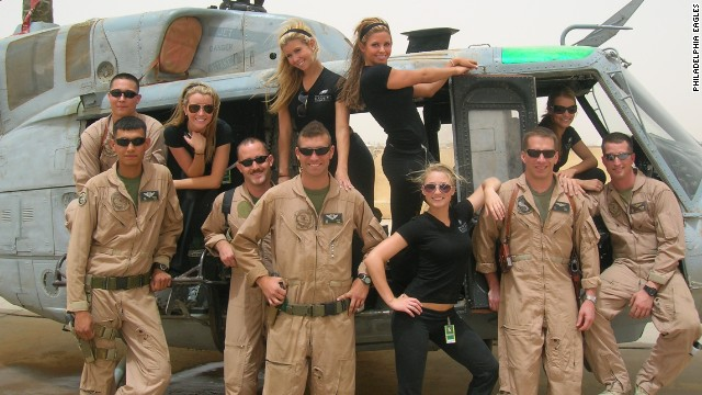 Washburn, standing at right in helicopter door, is seen on a Philadelphia Eagles goodwill tour of military units in Iraq.