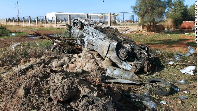A burnt-out vehicle is seen at the scene of a suicide bomber attack on December 22 outside Benghazi.