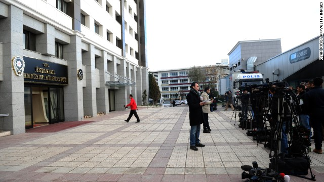 This file photo of journalists reporting outside of Istanbul Police Headquarters in Fatih, December 17.