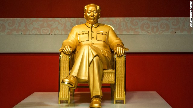 A gold and jade statue of Mao Zedong marks his 120th anniversary at an exhibition in Shenzhen in Southern China on December 13. The statue, is said to be worth more than $16 million.