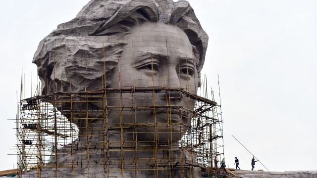 This picture taken on November 26 shows workers cleaning a statue of Mao Zedong still under construction in central China's Hunan province, ahead of the 120th anniversary of Mao's birth.