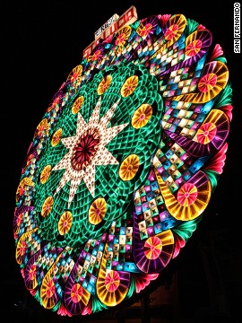 A finished giant Christmas parol lights up the night sky at the annual Christmas festival in San Fernando. Polyvinyl plastic in a hodgepodge of colors usually covers a giant parol.