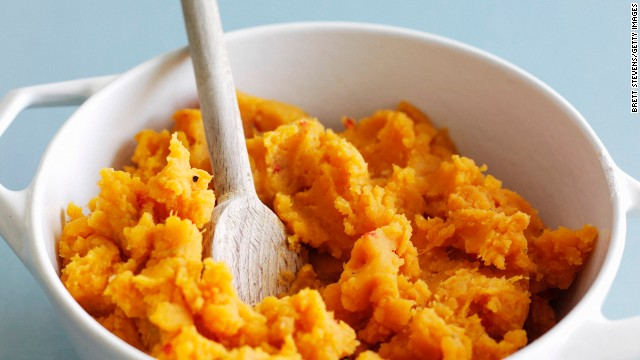 Eating <a href='http://www.health.com/health/gallery/0,,20600272,00.html' target='_blank'>sweet potatoes</a> can prevent sugar from getting stored around your waistline as fat. How? Sweet potatoes are rich in carotenoids -- the orange and yellow pigments in plants that help the body respond to insulin -- as well as CGA (also found in coffee).<!-- --> </br><!-- --> </br>Carotenoids and CGA slow the body's release of glucose and insulin, says Bowden. Plus, sweet potatoes are filled with fiber, which slows digestion and prevents blood sugar from plummeting -- and your hunger from spiking. <!-- --> </br><!-- --> </br><a href='http://www.health.com/health/recipe/0,,10000001547042,00.html' target='_blank'>Try this recipe: Maple-pecan sweet potato mash</a><!-- --> </br><!-- --> </br><i>This article originally appeared on </i><i><a href='http://www.health.com/health/gallery/0,,20735735,00.html' target='_blank'>Health.com</a></i><i>.</i>