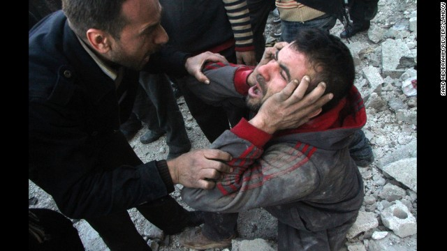 A man reacts after what activists said was an air raid by forces loyal to Syrian President Bashar al-Assad in the al-Marja district of Aleppo on Monday, December 23. The United Nations estimates more than 100,000 people have been killed since the Syrian conflict began in March 2011. Click through to see the most compelling images taken during the conflict, which is now a civil war:
