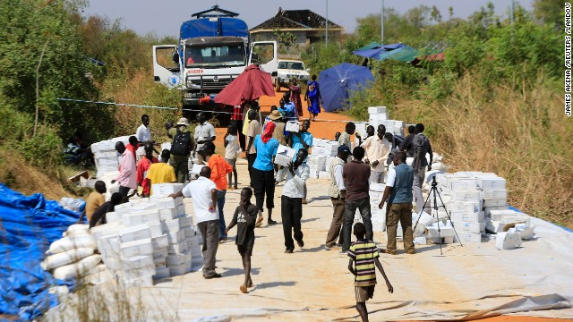 People gather to receive emergency dry food rations distributed by the World Food Program at a makeshift camp on December 23.