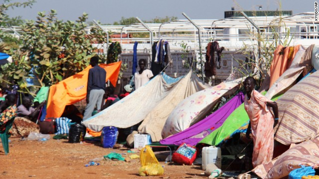 People taking refuge on December 22 near a camp of Japan's Ground Self-Defense Force, part of a U.N. peacekeeping mission in Juba.
