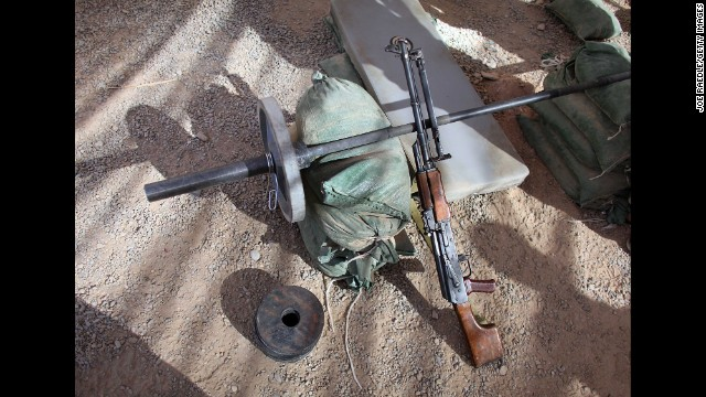 An AK-47 leans against a makeshift bench press that U.S. Marines built in their base in Delaram, Afghanistan, in 2009.