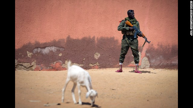 A soldier with the Malian army patrols a street in Gao, Mali, with an AK-47 on February 25, 2013.