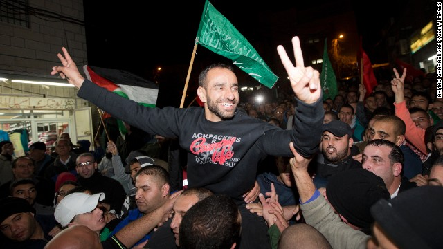 Palestinian prisoner, Samer Issawi who held a hunger strike for serveral months, celebrates his release from an Israeli jail.