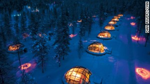 At Finland\'s Hotel Kakslauttanen, you view the Northern Lights from a glass igloo.